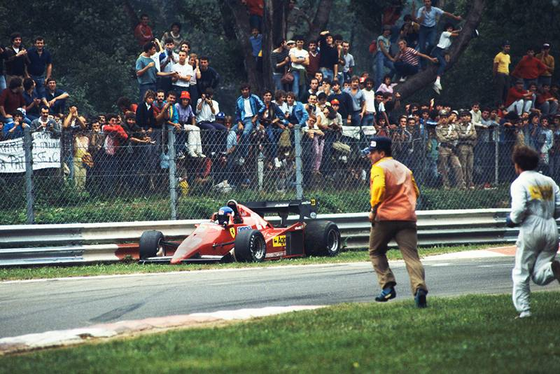 Marshals run to the assistance of Patrick Tambay after a spin.