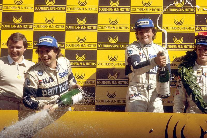Riccardo Patrese 1st position, Andrea de Cesaris 2nd position and Nelson Piquet 3rd position on the podium.