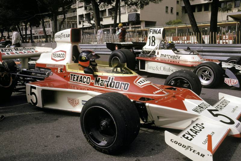 Emerson Fittipaldi sits in his McLaren on the starting grid at the start of the 1974 Monaco Grand Prix.