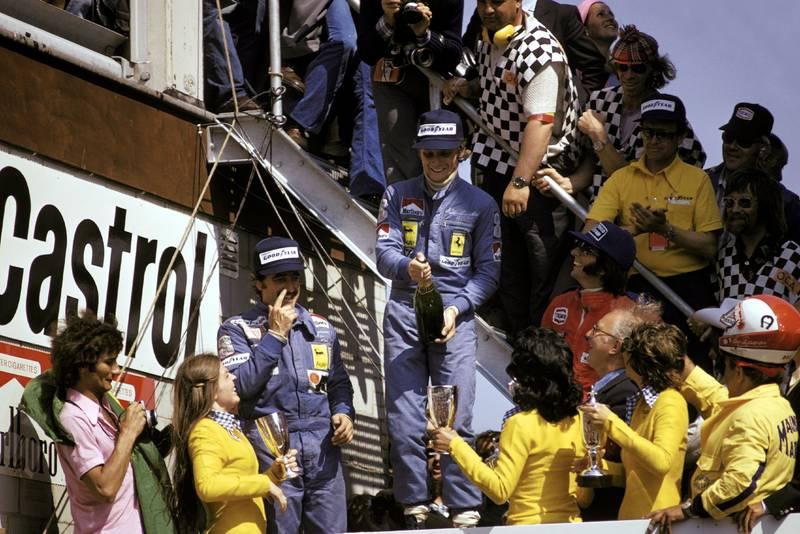 Nikia Lauda (Ferrari) celebrates winning the 1974 Dutch Grand Prix on the podium.