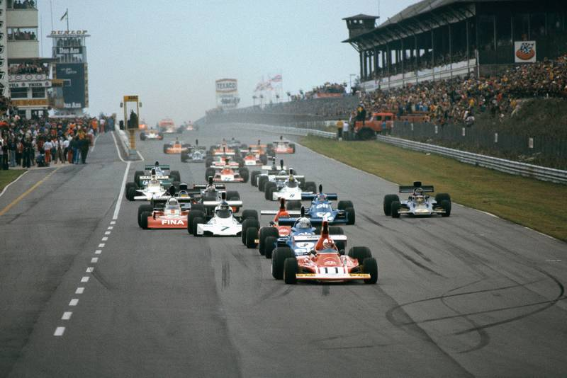 The cars head down to the first corner at the start of the 1974 Austrian Grand Prix.