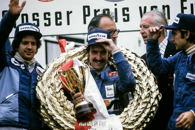 Clay Regazzoni smiles on the podium after winning the 1974 German Grand Prix, Nurburgring.