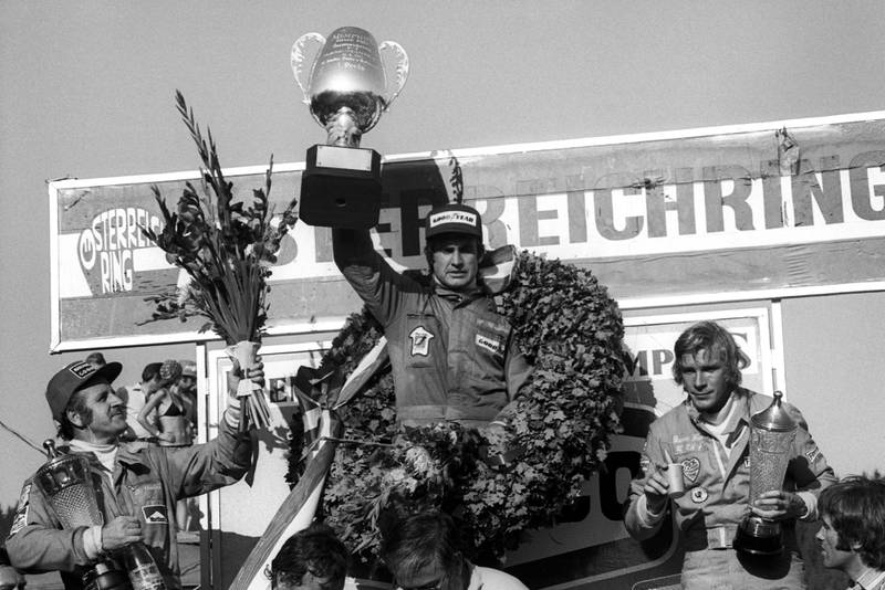 Carlos Reutemann (Brabham) holds his trophy aloft after winning the 1974 Austrian Grand Prix.