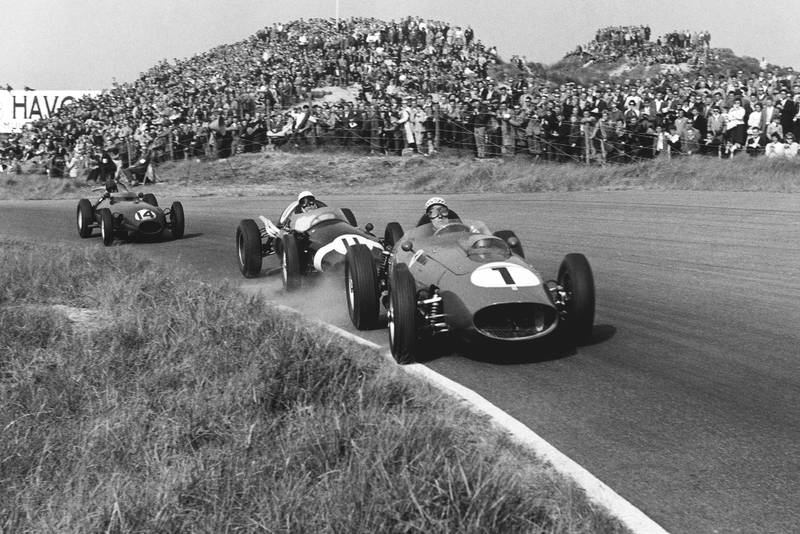 Jean Behra in a Ferrari Dino 246 leads Stirling Moss in a Cooper T51-Climax, and Graham Hill in his Lotus 16-Climax