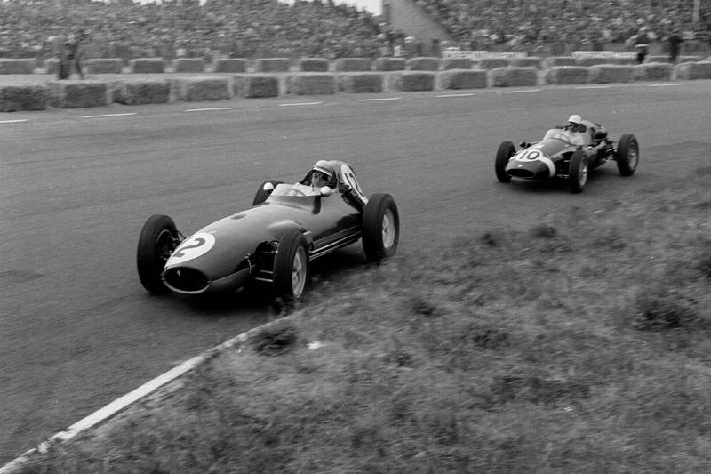Tony Brooks driving a Ferrari Dino 24 leads Maurice Trintignant in his Cooper T51-Climax.