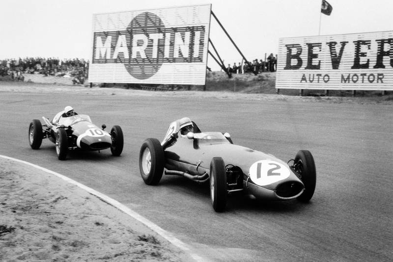 Innes Ireland driving a Lotus 16-Climax leads Maurice Trintignant at the wheel of a Cooper T51-Climax.