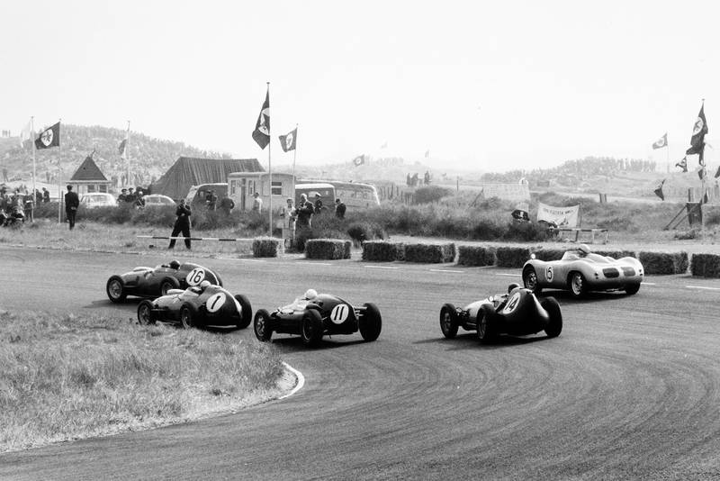 Cliff Allison in a Ferrari Dino 246, leads Jean Behra in his Ferrari Dino 246, Stirling Moss in a Cooper T51-Climax, Graham Hill in his Lotus 16-Climax, and Carel Godin de Beaufort in the Porsche RSK.