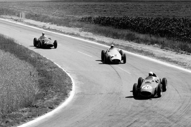 Phil Hill in a Ferrari Dino 246 leads Stirling Moss in his BRM P25 and Carel Godin de Beaufort's Maserati 250F.