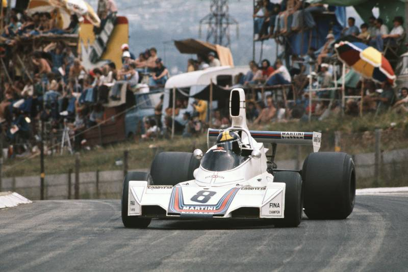Carlos Pace oversteers his Brabham at the 1975 South African Grand Prix, Kyalami.