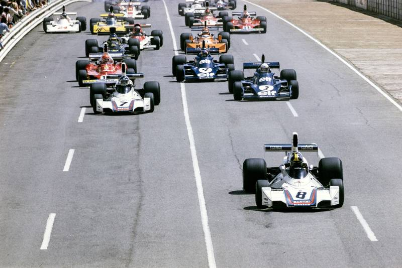 Carlos Pace leads the pack at the start of the 1975 South African Grand Prix, Kyalami.