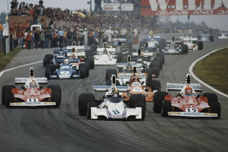 The field crowds into Turn One at the start of the 1975 Belgian Grand Prix, Zolder.