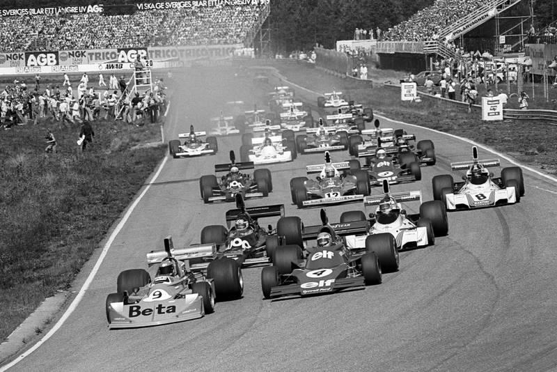 Vittorio Brambilla leads into the first corner of the 1975 Swedish Grand Prix, Anderstorp.