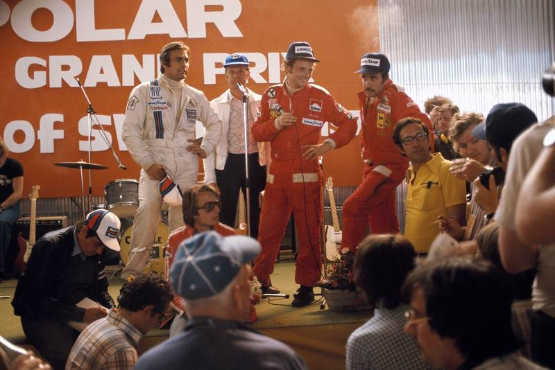 Niki Lauda (centre) faces the press at the end of the 1975 Swedish Grand Prix, Anderstorp.