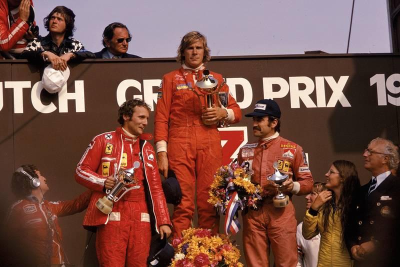 James Hunt (Hesketh) stand son the podium after winning the 1975 Dutch Grand Prix, Zandvoort.