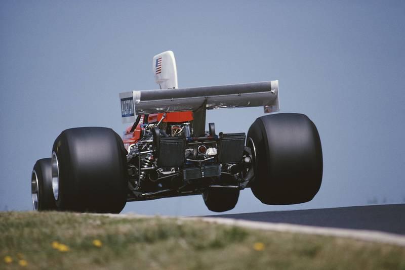 Mark Donahue (Penske) takes off down the Flugplatz at the 1975 German Grand Prix, Nurburgring.