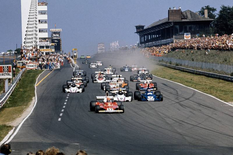 Niki Lauda leads the field into the first corner at the 1975 German Grand Prix, Nurburgring.