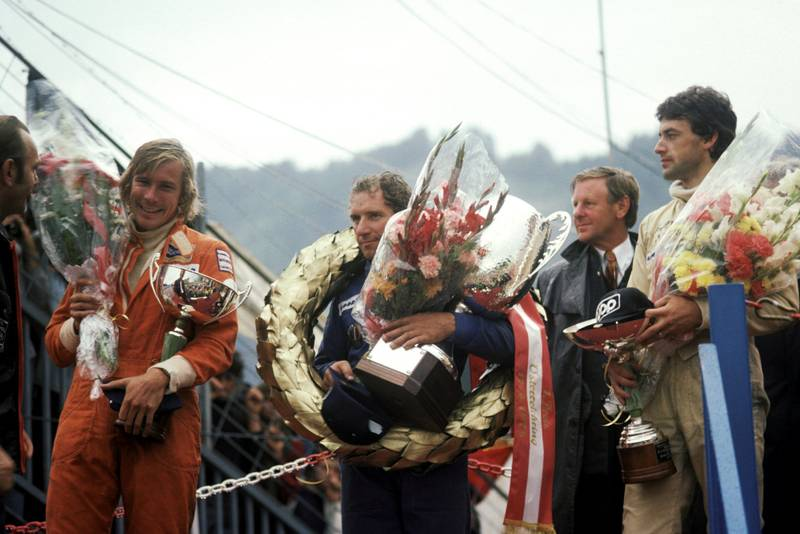 Vittorio Brambilla stands on the podium after winning the 1975 Austrian Grand Prix, Osterreichring.