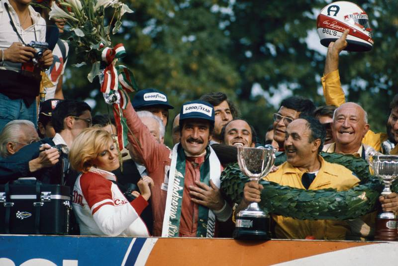 Clay Regazzoni holds his bouquet aloft after winning the 1975 Italian Grand Prix, Monza.