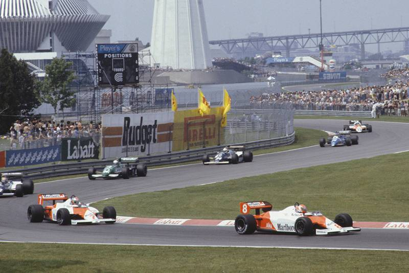 Niki Lauda (McLaren MP4-1C Ford), leads team-mate John Watson, Roberto Guerrero (Theodore N183 Ford), Danny Sullivan (Tyrrell 011 Ford), Johnny Cecotto (Theodore N183 Ford), Raul Boesel (Ligier JS21 Ford), and Mauro Baldi, (Alfa Romeo 183T).