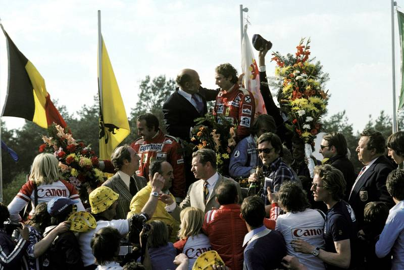 Niki Lauda celebrate son the podium after winning the 1976 Belgian Grand Prix.