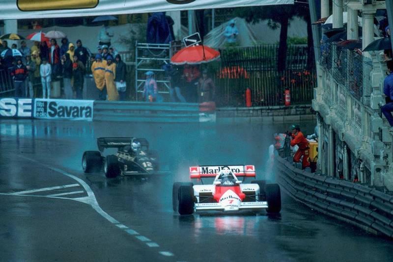 Winner Alain Prost McLaren MP4/2 leads a Lotus.