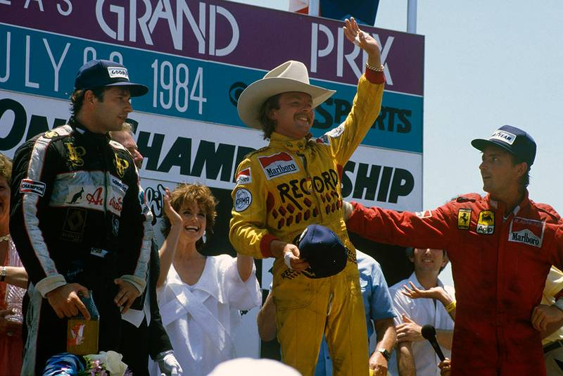 Keke Rosberg, 1st position, Elio de Angelis, 2nd position and Rene Arnoux, 3rd position on the podium.