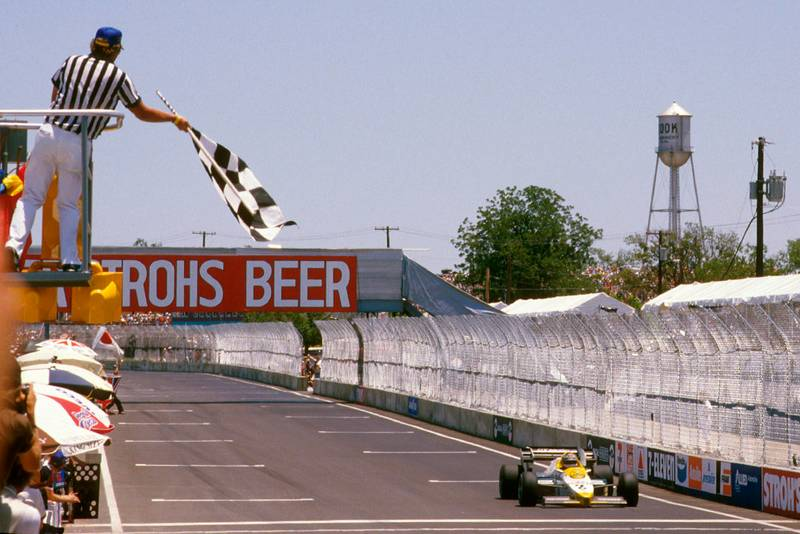 Keke Rosberg takes the chequered flag for the win.