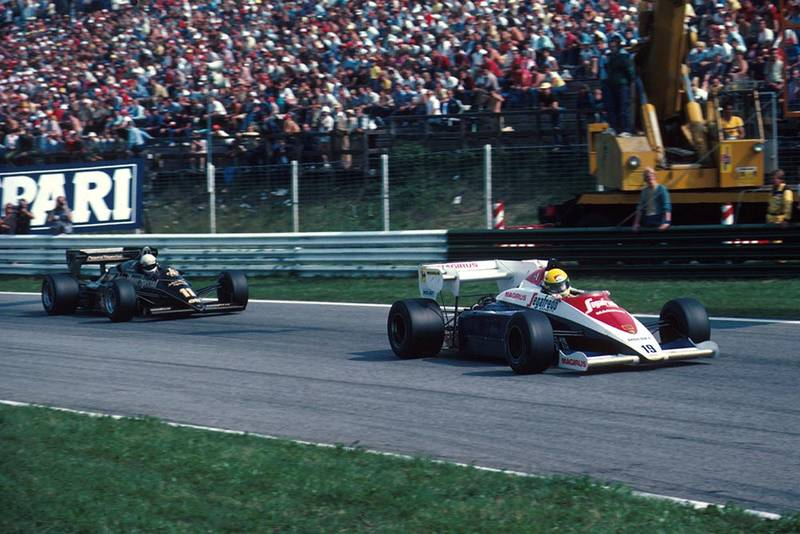 Ayrton Senna's Toleman, leading Elio de Angelis in his Lotus.
