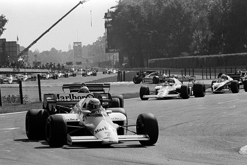 Alain Prost in a McLaren MP4/2 leads all the field except the pole sitter on the warm up lap. He retired from the race on lap 4 with a blown engine..