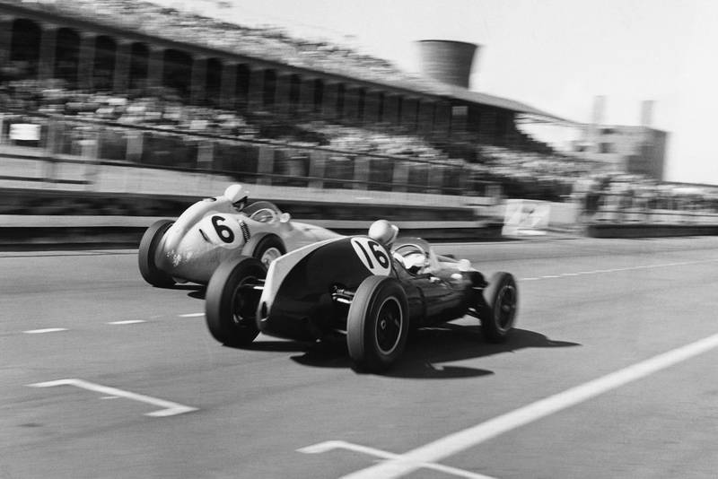 Stirling Moss in his BRM P25 passes Bruce McLaren in a Cooper-Climax T45.