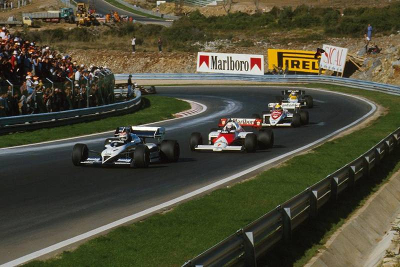 Nelson Piquet is chased by race winner Alain Prost and Ayrton Senna.