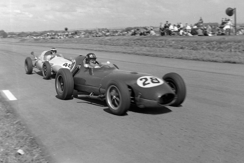 Graham Hill driving a Lotus 16 Climax, leads Chris Bristow in a Cooper T51 Borgward.