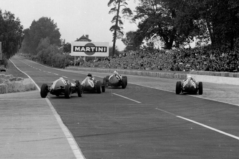 Jo Bonnier driving a BRM P25 leads Dan Gurney and Phil Hill in Ferrari Dino 246) and Bruce McLaren in hisCooper T45 Climax out of the Hairpin.
