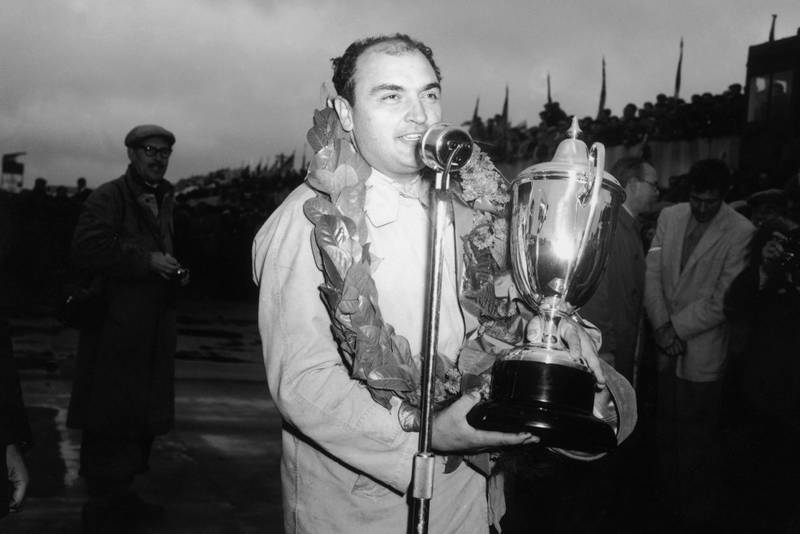 17th July 1954: Argentinian driver Jose Froilan Gonzalez with his Grand Prix trophy after a win at Silverstone.