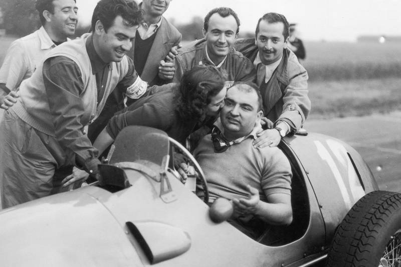 14th July 1951: Jose Frolien Gonzalez is kissed by his wife after winning the British Grand Prix at Silverstone in his Ferrari 375. (Photo by Douglas Miller/Keystone/Getty Images)