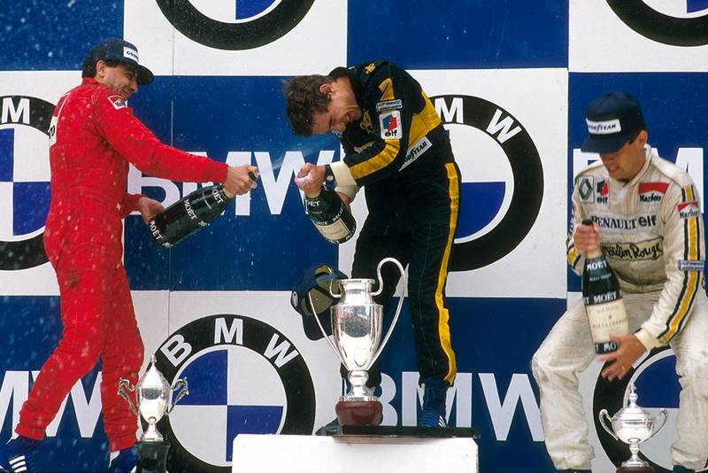 Ayrton Senna 1st position, Michele Alboreto 2nd position and Patrick Tambay 3rd position on the podium.