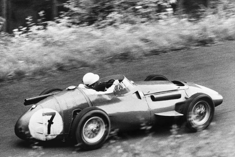 Stirling Moss on his way to second place in his Maserati 250F, 1956 German Grand Prix, Nurburgring.