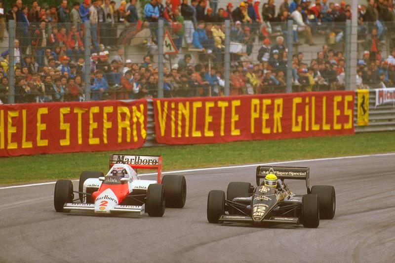 Alain Prost (McLaren MP4/2B TAG Porsche) battles with Ayrton Senna (Lotus 97T Renault) on the way to 1st position.