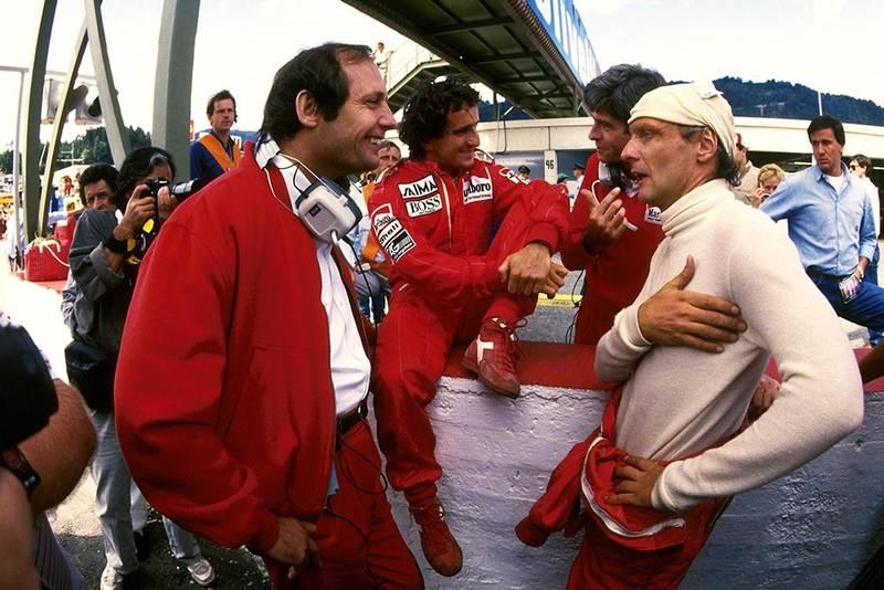 McLaren driver Niki Lauda chats with Team Boss Ron Dennis and race winner Alain Prost.