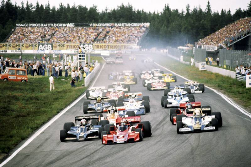 John Watson (Brabham) leads as the cars head for the first corner at the 1977 Swedish Grand Prix, Anderstorp.