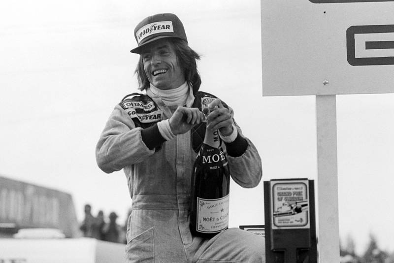 Jacuqes Laffite celebrates winning the 1977 Swedish Grand Prix, Anderstorp.