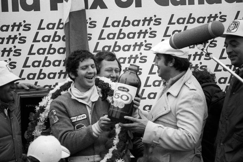Jody Scheckter (Wolf) is overjoyed with his win at the 1977 Canadian Grand Prix, Mosport Park.