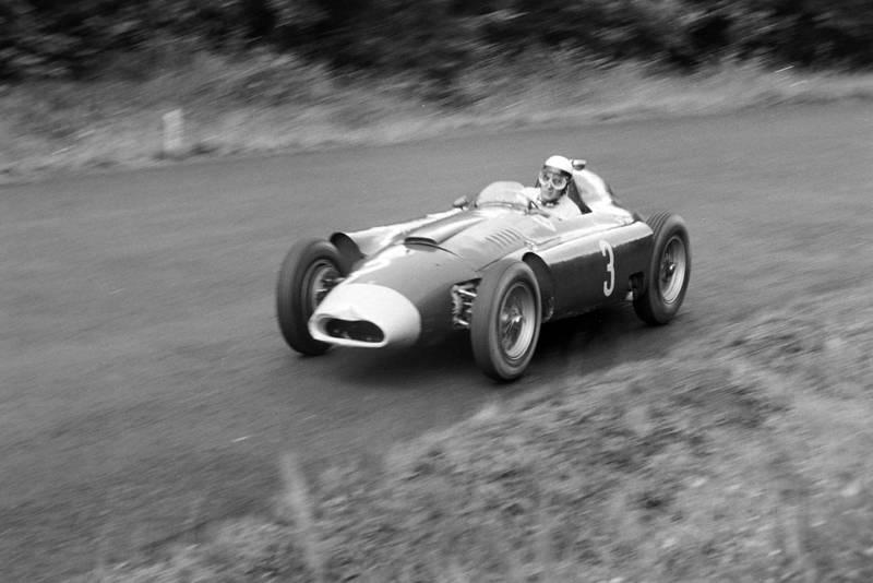 Eugenio Castellotti in his slightly battered Ferrari/Lancia D50 during the 1956 German Grand Pix, Nurburgring.