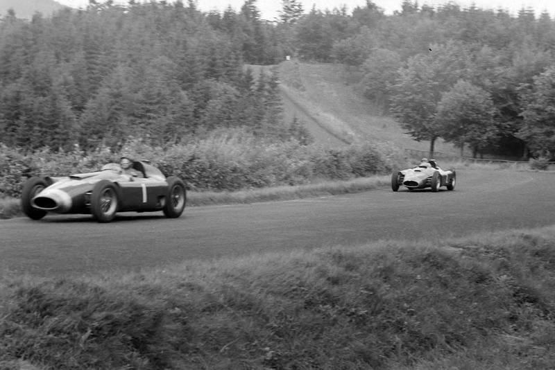 Juan Manuel Fangio, Ferrari D50, leads Peter Collins, Ferrari D50 at the 1956 German Grand Prix, Nurburgring.