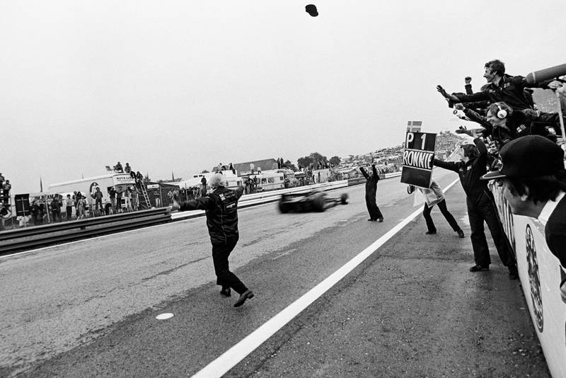 ROnnie Peterson (Lotus) passes the finish line to win the 1978 Austrian Grand Prix.