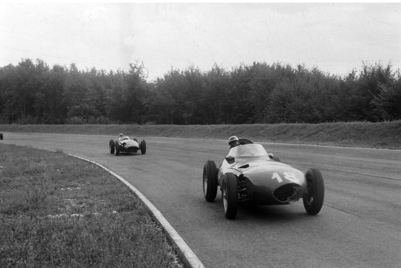 Harry Schell, Vanwall, leads Stirling Moss, Maserati 250F, during the 1956 Italian Grand Prix, Monza.