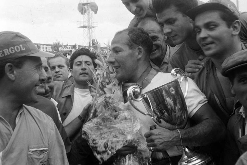 Stirling Moss celebrates victory at the 1956 Italian Grand Prix, Monza