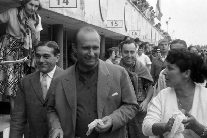 Juan Manuel Fangio smiles upon relasing he is champion for the fourth time.