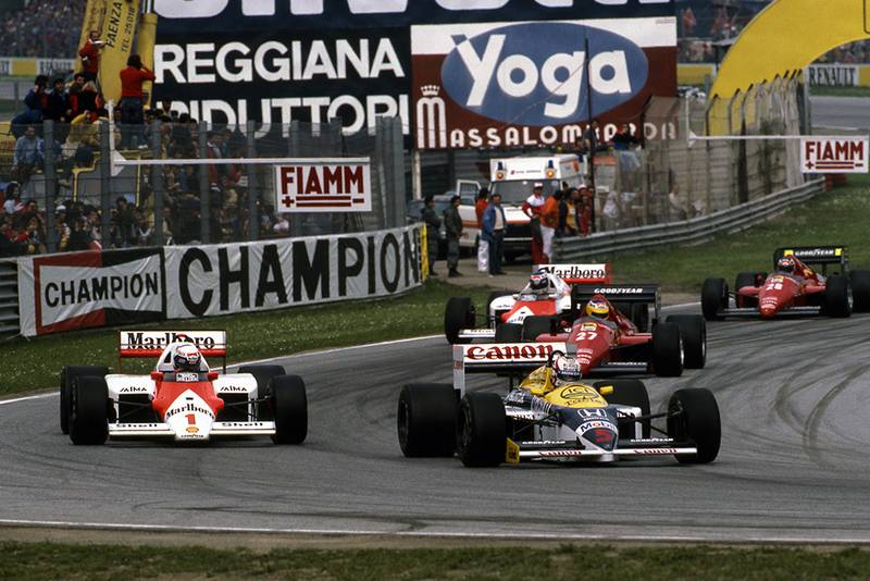 Nigel Mansell, Williams FW11, and Alain Prost, McLaren MP4/2C lead the pack.
