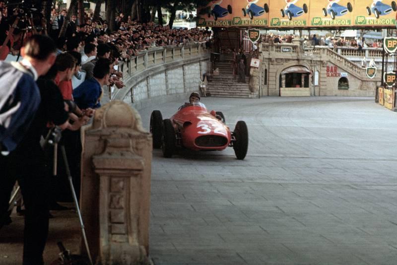 Juan Manuel Fangio races past the crowd in his Ferrari at the 1957 Monaco Grand Prix.